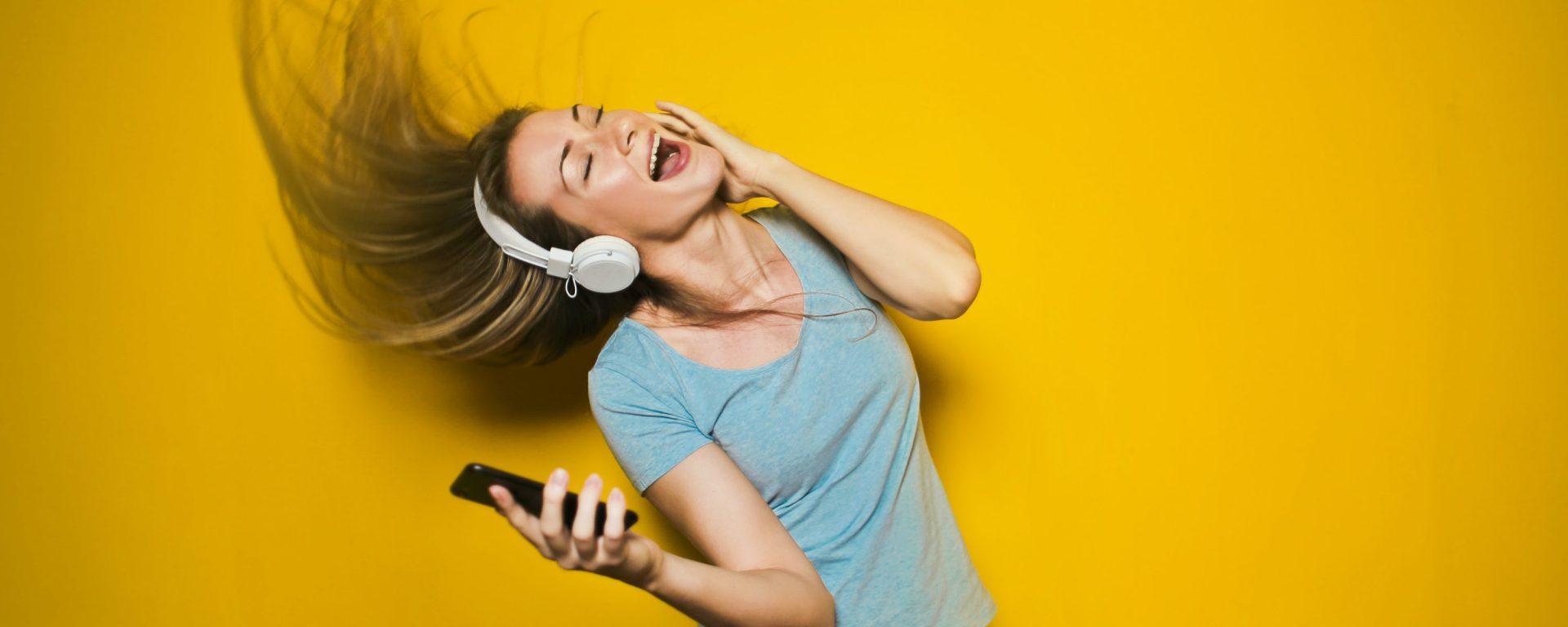 Dancing woman with headphones