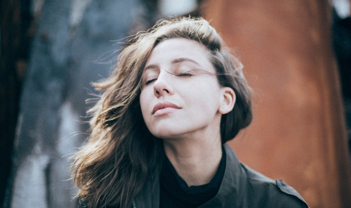 Woman calming down from stress. Image: Eli DeFaria on Unsplash