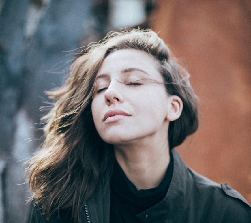 Woman calming down from stress. Image: Eli DeFaria on Unsplash