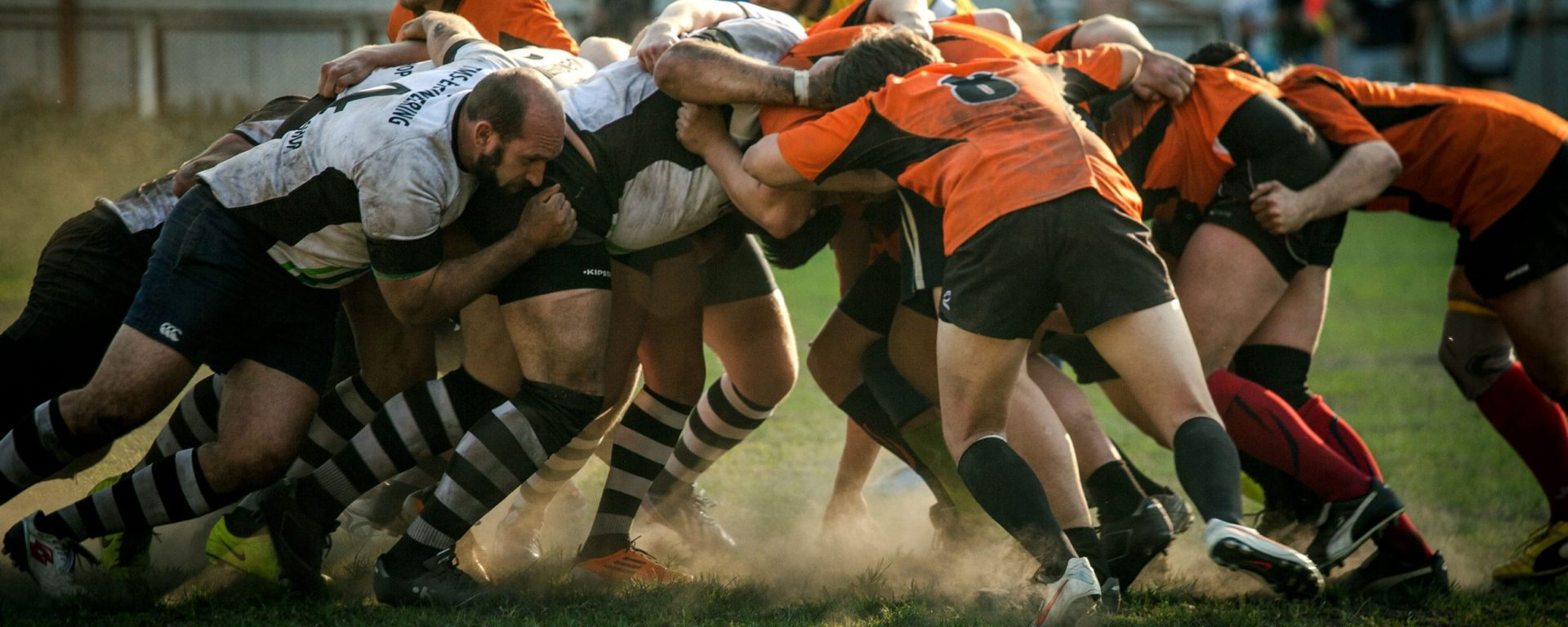 Sports players in scrum. Image: Olga Guryanova via Unsplash