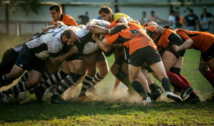 Sports players in scrum. Image: Olga Guryanova via Unsplash