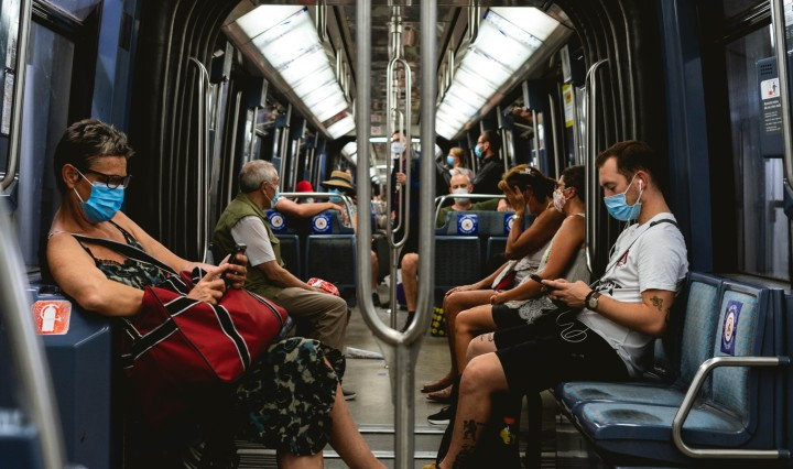 Commuters wearing mask on train. Image: Davyn Ben via Unsplash