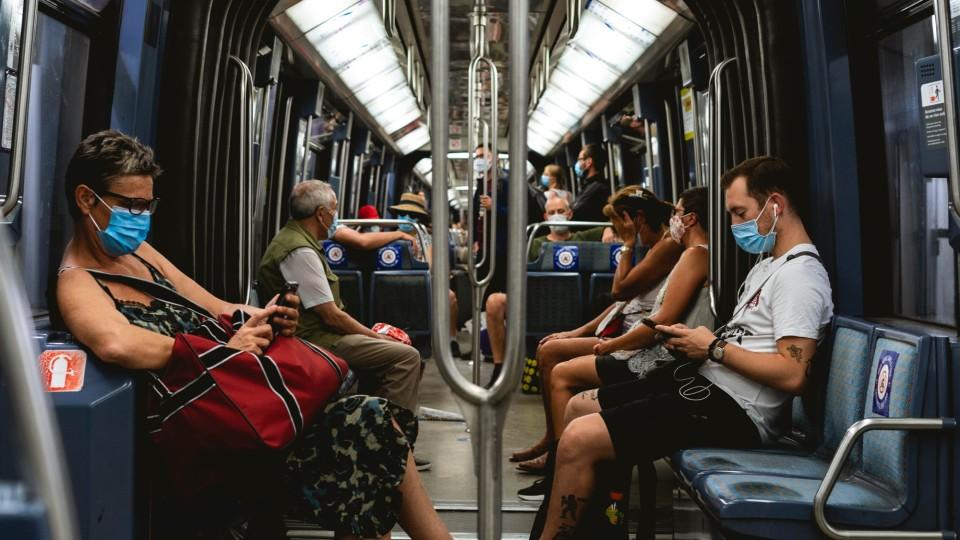 Commuters wearing mask on train. Image: Davyn Ben via Unsplash