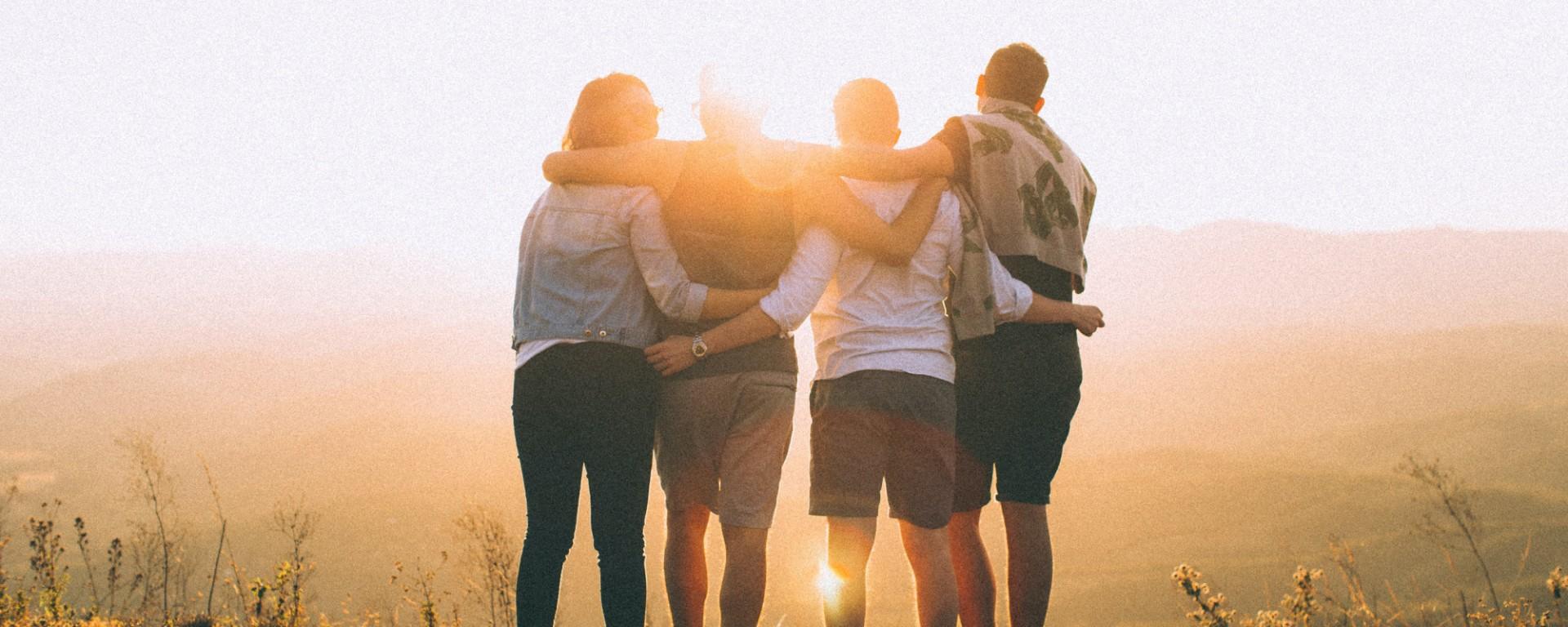 People hugging. Image: Helena Lopes via Unsplash